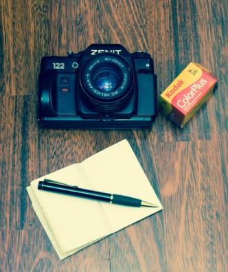 zenit 122 slr camera Helios 44-M-5 F/2 lens kodak colorplus film green pen and notebook