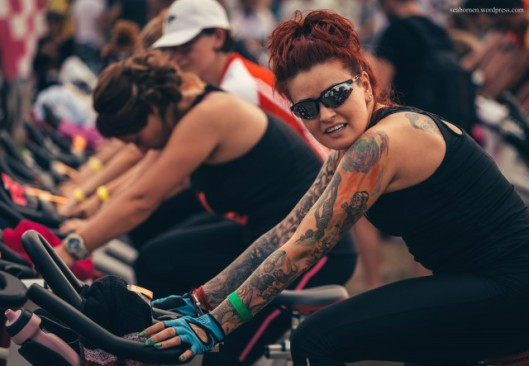 Cool redhaired lady with tatoos cycling