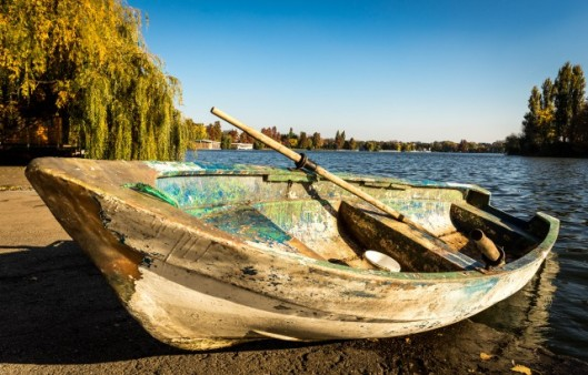 Old boat with paddles on Herastrau Lake