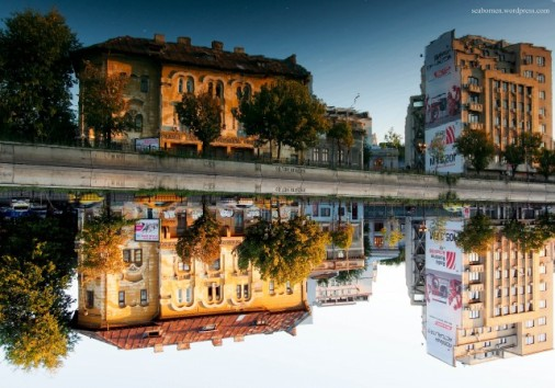 Building Reflections at golden hour on Dambovita River Bucharest