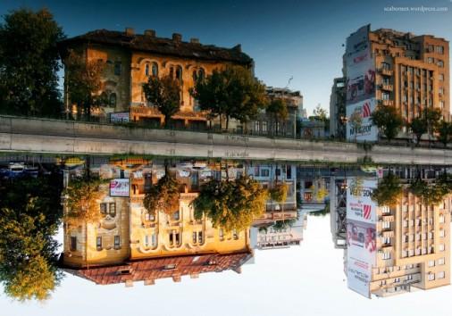 Building Reflections at golden hour on Dambovita River Bucharest
